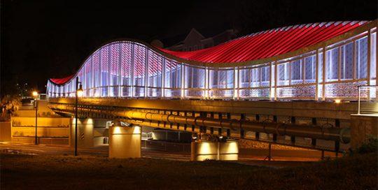 Depot Avenue Trail Pedestrian Bridge at night.
