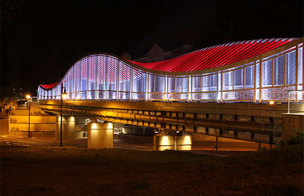 Depot Avenue Trail Pedestrian Bridge at night.