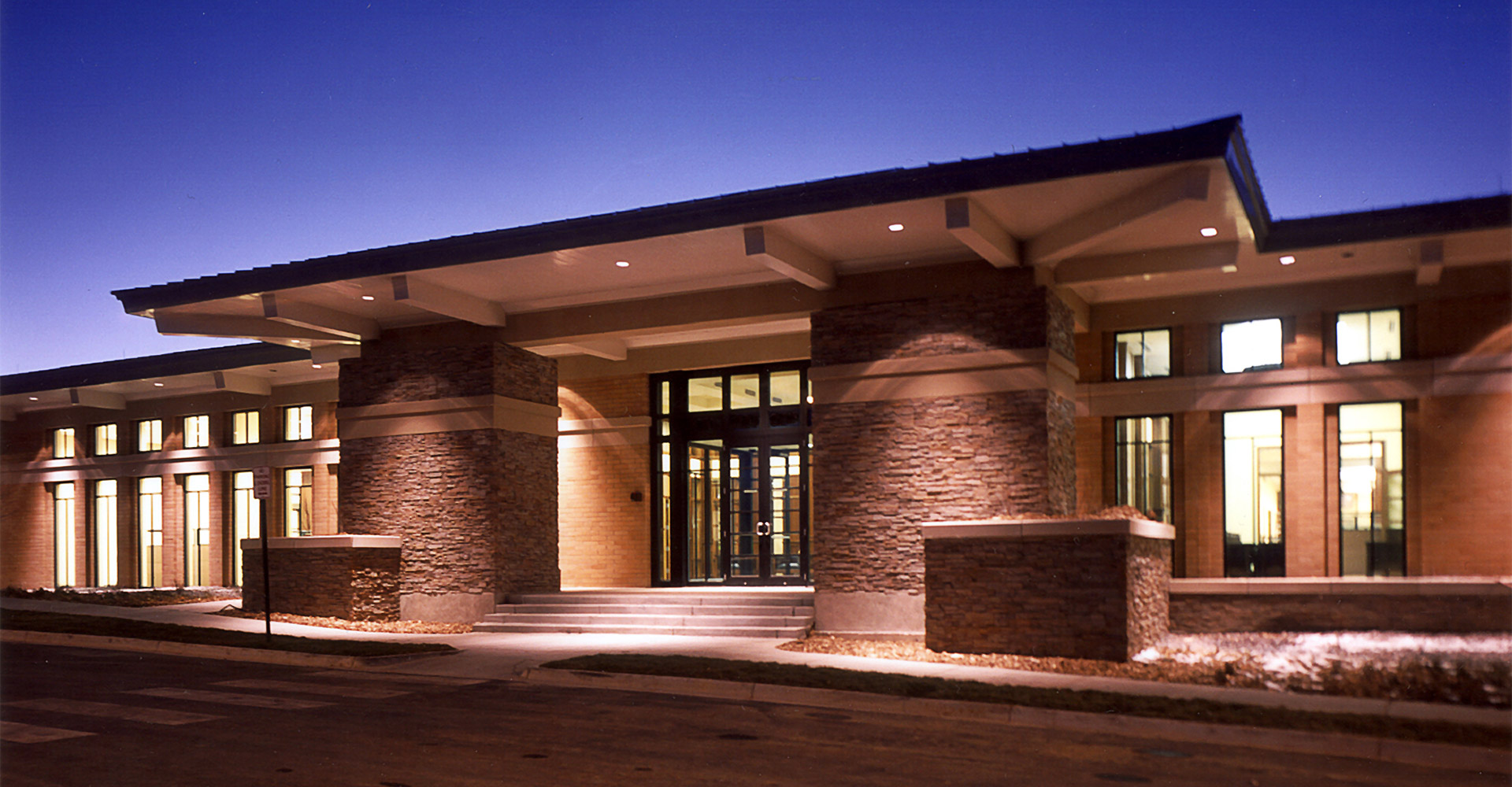 Exterior entrance of ADT Denver office at night.