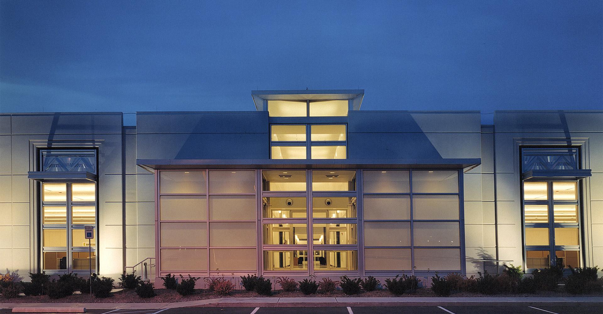 Exterior side door of ADT building at night.