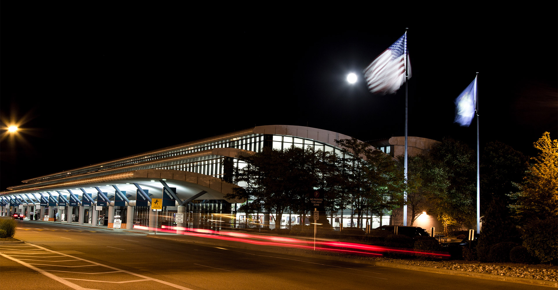 Exterior of Bishop International Airport at night.