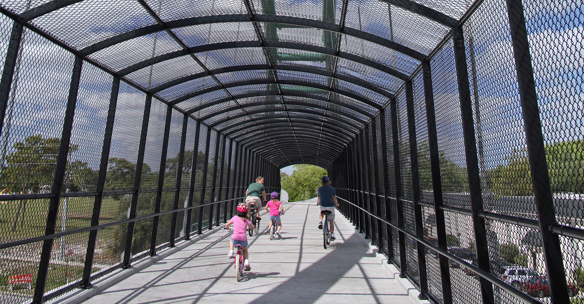 Biking across the Cady Way Trail and Pedestrian Bridge.