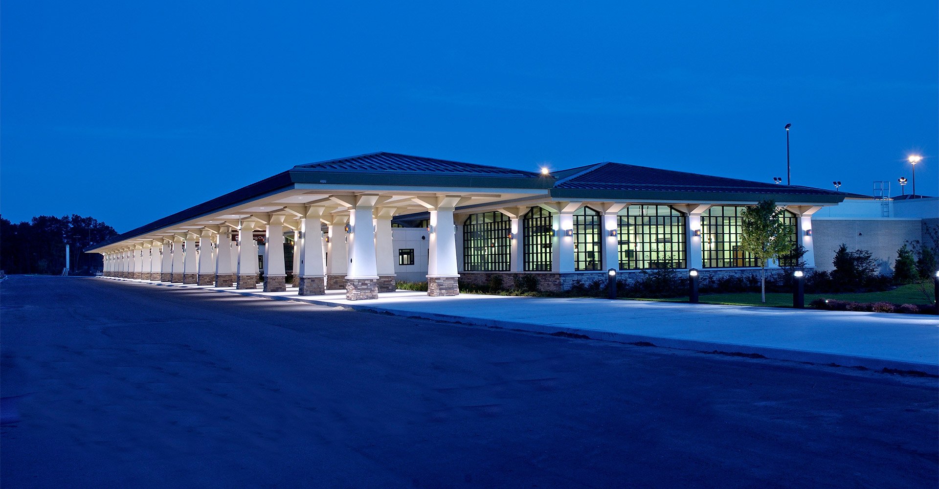 Exterior of Cherry Capital Airport at night.