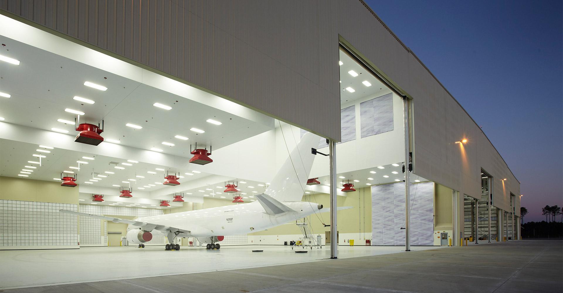 Looking into FSCJ aircraft service hangar at night.
