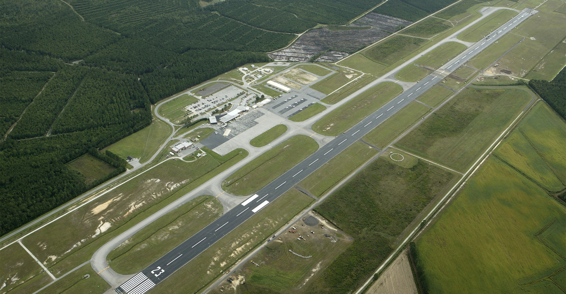 Aerial of Albert J Ellis International Airport runway.