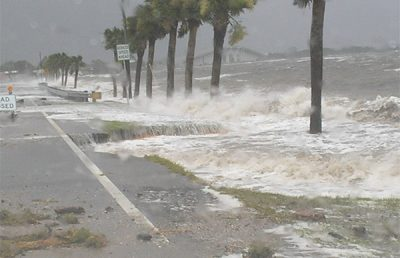 Water flooding the road during Hurricane Dennis.