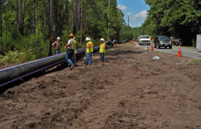 Workers on Race Track Road for reclaimed water extensions.