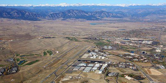 Rocky Mountain Metro Airport aerial with mountains.