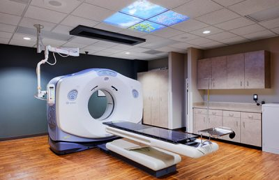 Round Rock Cancer Center examination room with machine.