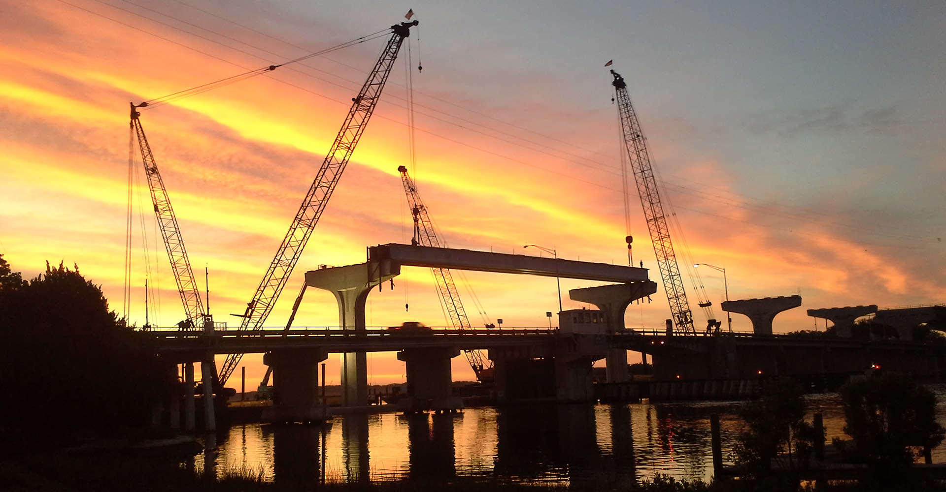 SR 105 Bridge Replacement construction silhouette at sunset.