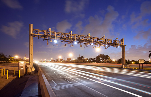 Electronic tolling facility at night.