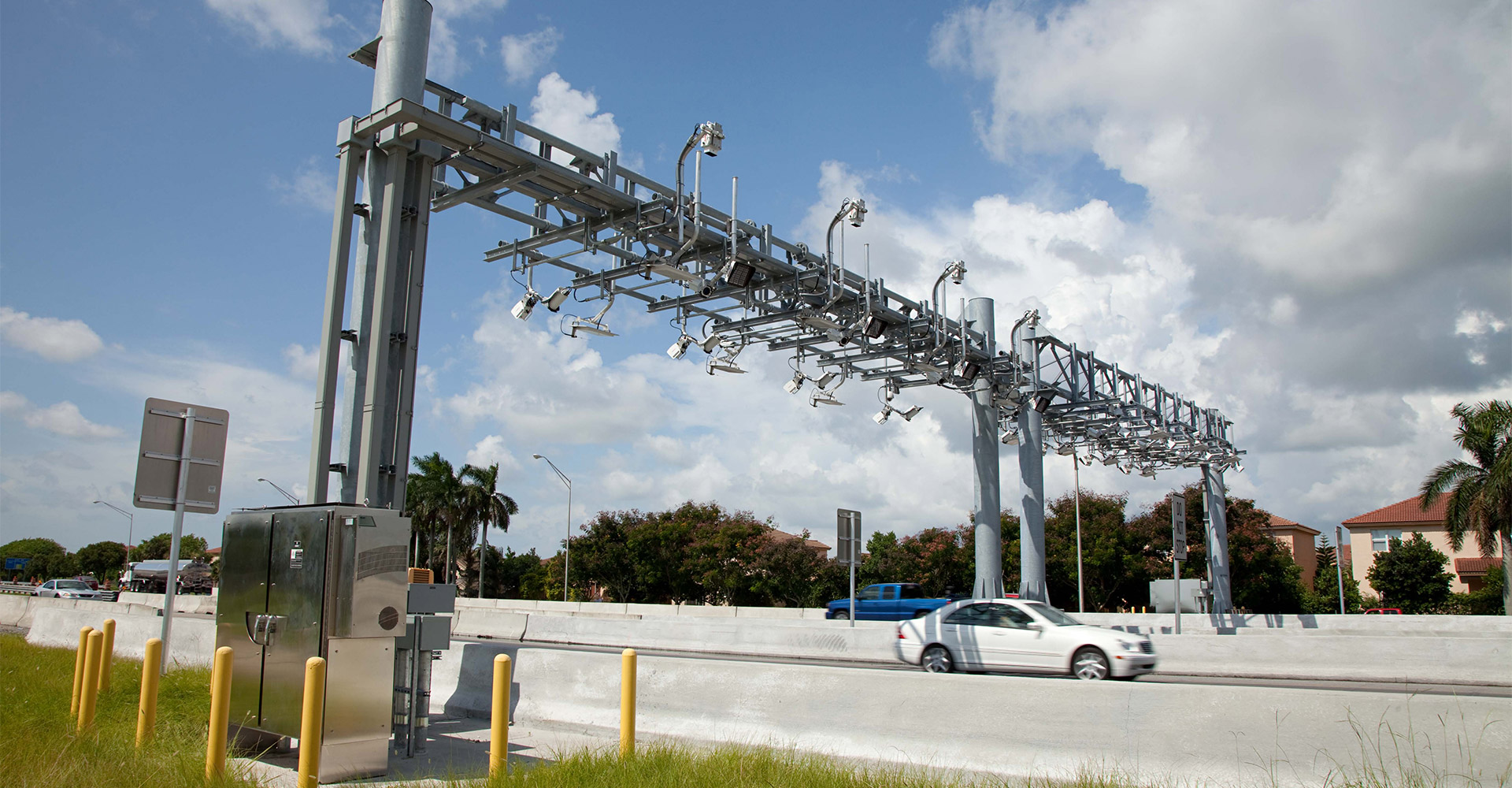 Vehicles driving under electronic tolling facility.