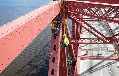 Workers repairing the Mathews Bridge.