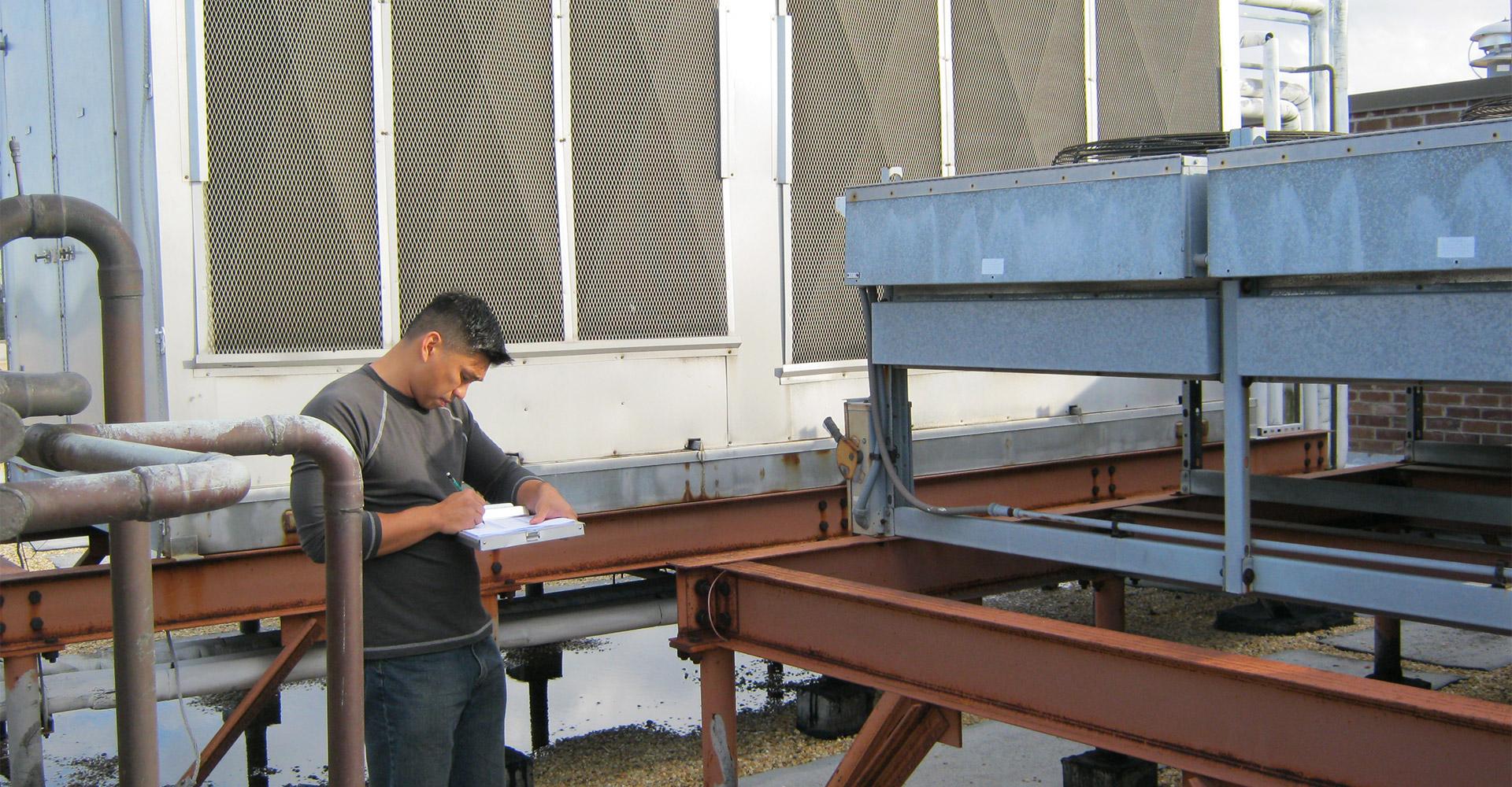 Man writing on clipboard.