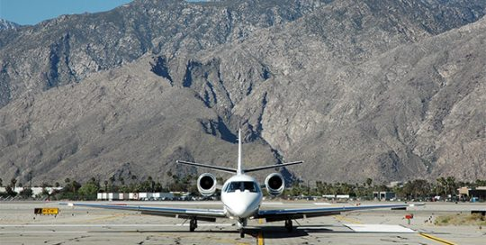 Plane on runway at Palm Springs International Airport.