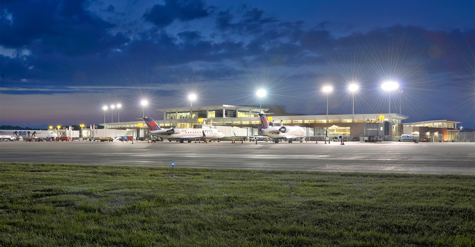 Exterior of Peoria International Airport at night.