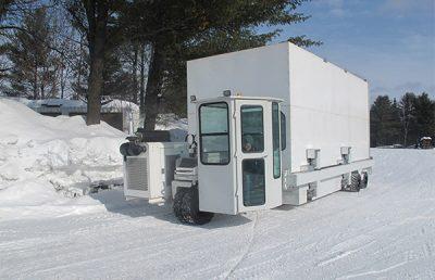 Jet engine transport system driving through snow.
