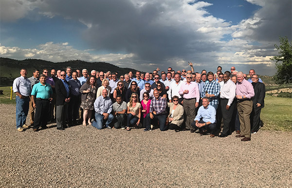 Group photo of company officers in Denver, Colorado.
