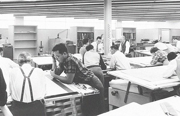 Historical photo of men working at drafting tables.