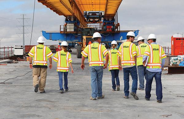 Construction Management associates walking on a job site.