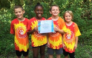 Students hold Elevate grant certificate at Tree Hill Nature Center