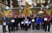 CASA Kane County staff holding Elevate Fund certificates.