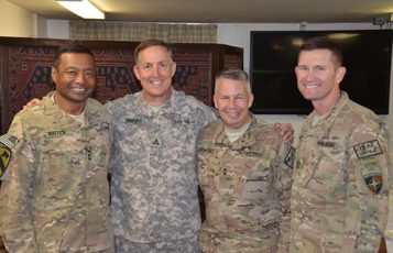 Current RS&H Military Programs Leader Gordy Simmons poses with U.S.A.C.E. colleagues.